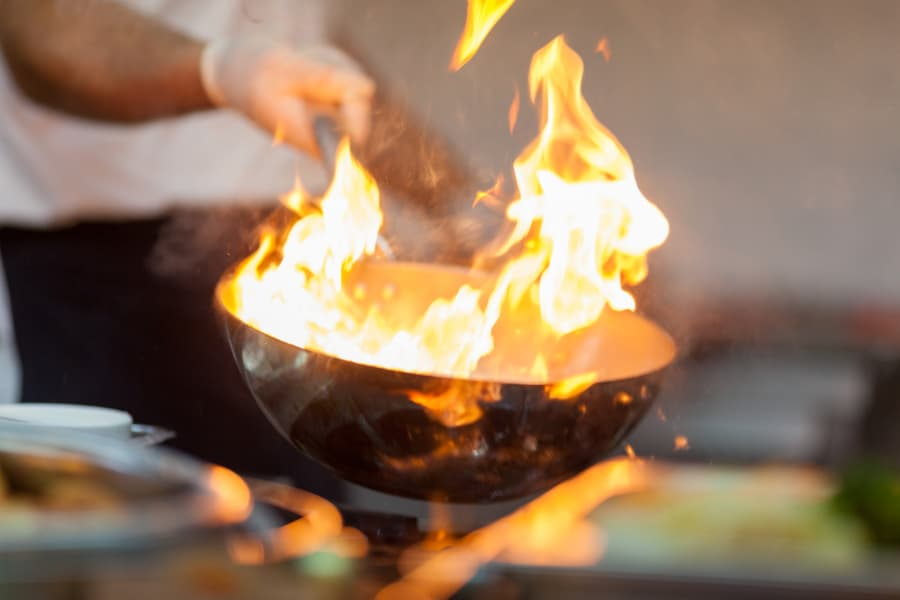 Chef Manages A Pan Oil Fire