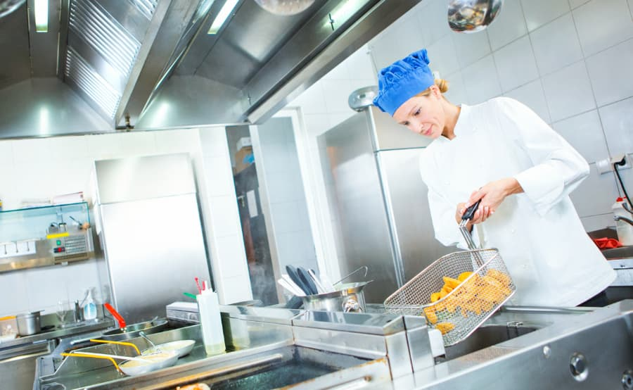 Chef Tosses Food In Deep Fryer