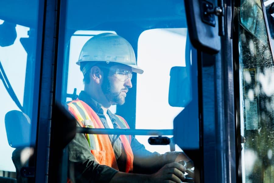 Worker operating heavy machinery