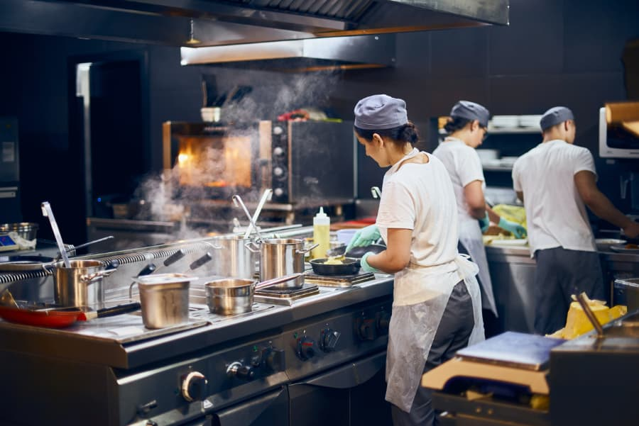 Cooks working in restaurant kitchen
