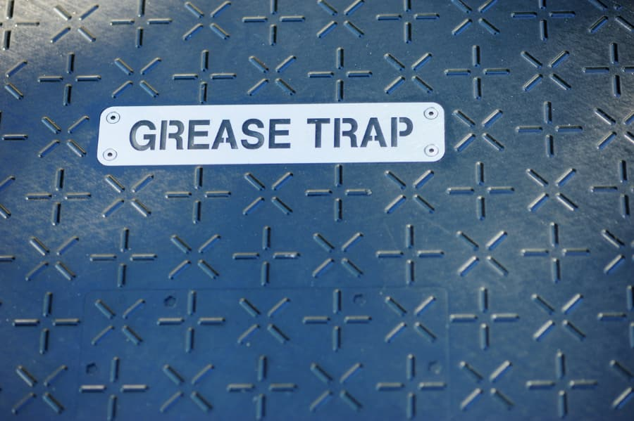 Grease trap sign on door