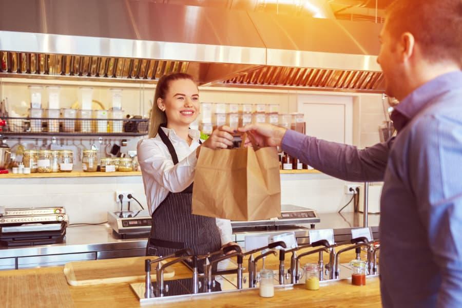 Waitress Serves Customer Take-Out